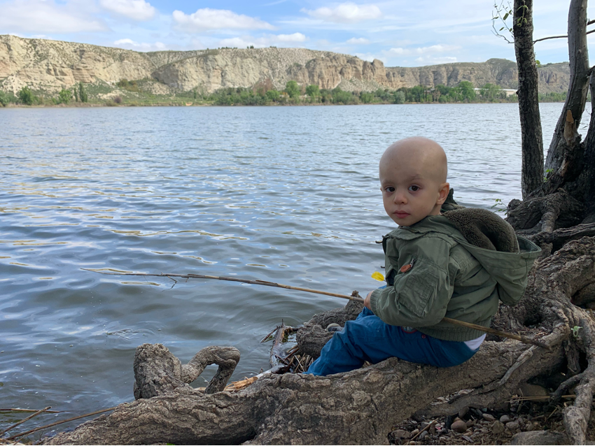 Leo sitting by the lake