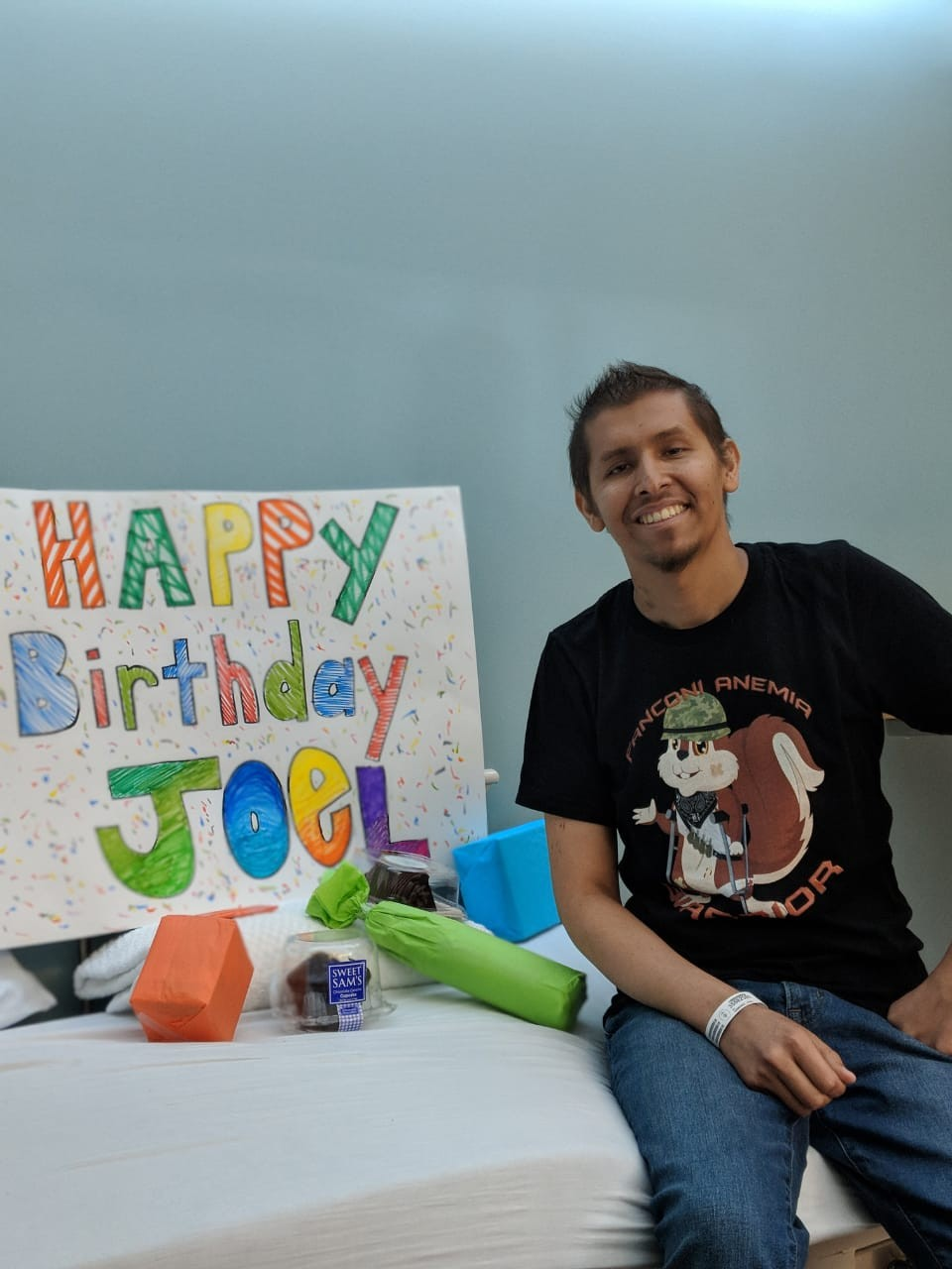 Joel with a birthday sign