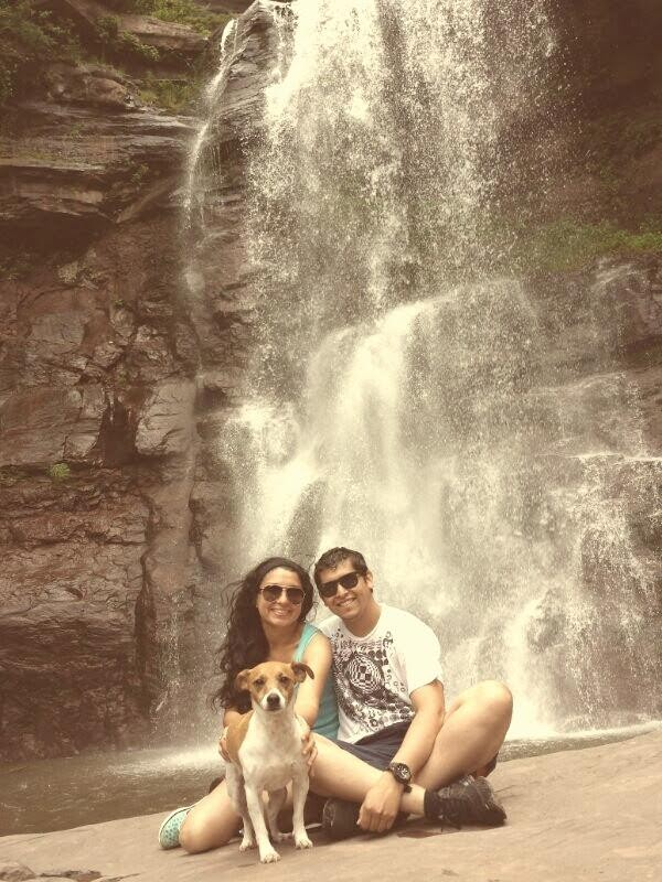Natalia and Joel in front of a waterfall